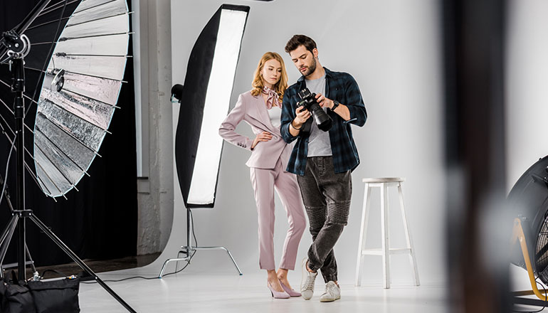 photographer and female model in photo studio
